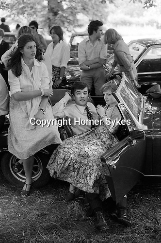 The Fourth of June Eton College old scholars and girl friends watching the inter house cricket match near Windsor England 1978.