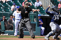 Home plate umpire Bryan Fields calls a third strike during the game between  the Iowa Cubs and New Orleans Zephyrs  at Principal Park on April 13, 2016 in Des Moines, Iowa.  The Cubs won 9-5 .  (Dennis Hubbard/Four Seam Images)