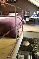 The cosy bedroom is situated on a mezzanine under the eaves of the loft and is lit by a skylight