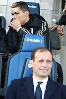 Cristiano Ronaldo Juventus on the bench behind coach Massimiliano Allegri <br /> Bergamo 26-12-2018  Stadio Atleti Azzurri d'Italia <br /> Football Campionato Serie A 2018/2019 <br /> Atalanta - Juventus<br /> Foto Cesare Purini / Insidefoto