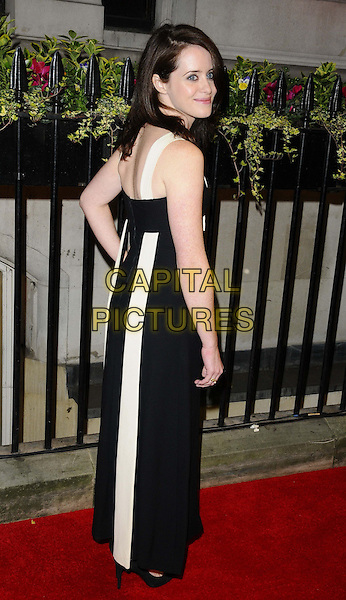 Claire Foy<br /> The Luminous BFI gala dinner &amp; auction, 8 Northumberland Avenue, Northumberland Avenue, London, England.<br /> October 8th, 2013<br /> full length black dress white looking over shoulder <br /> CAP/CAN<br /> &copy;Can Nguyen/Capital Pictures