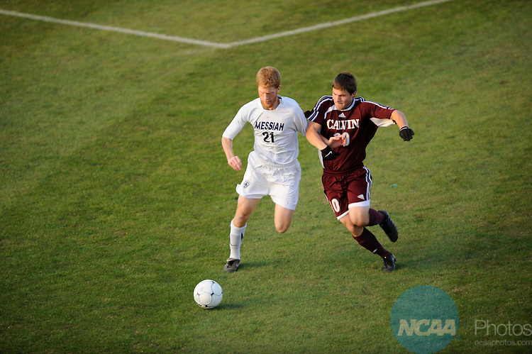 05 DEC 2009:  Jon Burke (21) of Messiah College dribbles past Scott Hooker (20) of Calvin College during the Division III Men's Soccer Championship held at Blossom Soccer Stadium hosted by Trinity University in San Antonio, TX. Messiah defeated Calvin 2-0 for the national title.  Brett Wilhelm/NCAA Photos