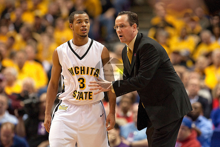 March 6,  2010          Wichita State head coach Gregg Marshall speaks to Wichita State guard Clevin Hannah (3) during a break in the action in the first half.    Wichita State defeated Illinois State by a score of 65-61 in the second of two semifinals played on Saturday March 6, 2010 at the Missouri Valley Conference Tournament.  The tournament is being held at the Scottrade Center in downtown St. Louis.  Wichita State advances to play the University of Northern Iowa for the MVC Tournament Championship.  The winner earns an automatic berth in the NCAA Tournament.