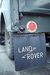 Rear mudflap with the Land Rover sign as fitted to an original and unrestored Land Rover Series 1 80 inch Tickford Station Wagon, engine 1498cc petrol, registration HSL 605, chassis no. L06200409 . Part of the Dunsfold Collection of Landrovers, Surrey, UK. NO RELEASES AVAILABLE. Automotive trademarks are the property of the trademark holder, authorization may be needed for some uses. --- Info: This is one of the Tickford built 80 inch Station Wagons built 1949/50. This vehicle was sent when new to UNICEF in Finland with one other for delivery of mothers milk in 1950. After 10 years it was fitted with a PTO and had a large air compressor installed in the rear and lived in a quarry blowing up truck tyres. This is most likely the most original unrestored example around.