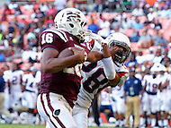 September 7, 2013  (Washington, DC)  Joshua Harris (QB) #16, of the Morehouse Maroon Tigers, stiff arms Kenneth Russ (DB) #28 during a run in the 2013 AT&T Nations Classic against the Howard Bison.  (Photo by Don Baxter/Media Images International)