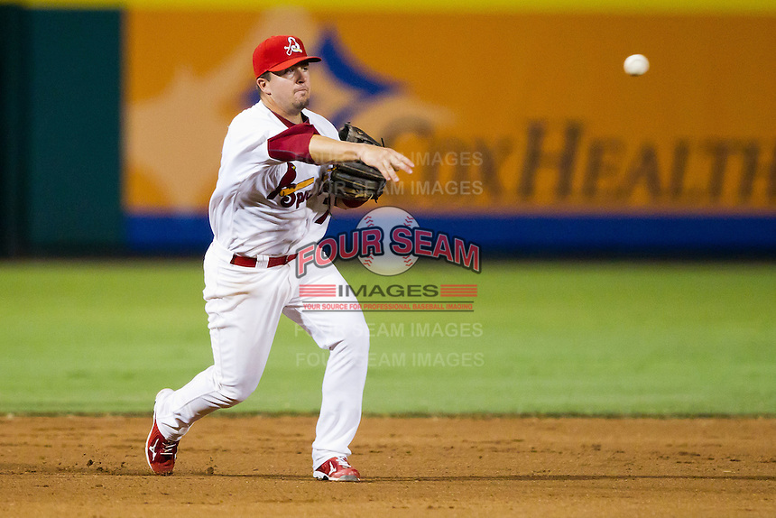 Zack Cox (7) of the Springfield Cardinals throws to first during a game against the Tulsa Drillers at Hammons Field on July 20, 2011 in Springfield, Missouri. Springfield defeated Tulsa 12-1. (David Welker / Four Seam Images)