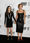 "HOLLYWOOD, CA. - September 29: Ellen Page and Drew Barrymore arrive at the Los Angeles premiere of ""Whip It"" at the Grauman's Chinese Theatre on September 29, 2009 in Hollywood, California."