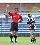 Referee Jim Hickey calls for assistance for an injured Rachel Guerin of Bridgetown during their Schools Division 6 final at Cusack Park. Photograph by John Kelly