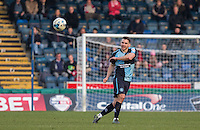 Matt Bloomfield of Wycombe Wanderers plays the ball forward during the Sky Bet League 2 match between Wycombe Wanderers and Stevenage at Adams Park, High Wycombe, England on 12 March 2016. Photo by Andy Rowland/PRiME Media Images.