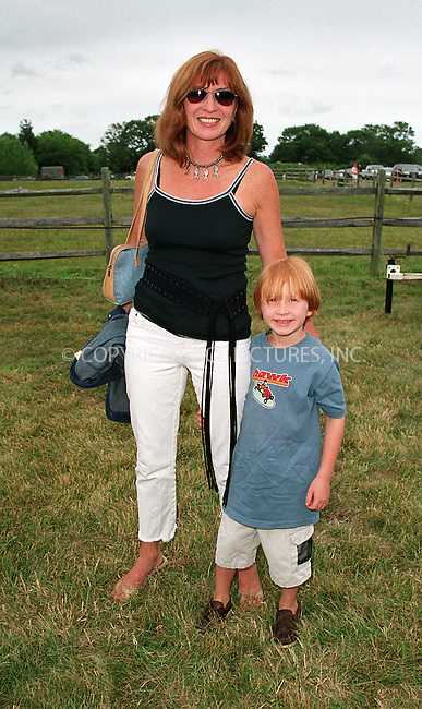 "Nicole Miller with her son Palmer at the Fifth Annual ""Super Saturday"" designer sale and family event to benefit the ovarian cancer research fund. Water Mill, Long Island. July 27, 2002. Please byline: Alecsey Boldeskul/NY Photo Press.   ..*PAY-PER-USE*      ....NY Photo Press:  ..phone (646) 267-6913;   ..e-mail: info@nyphotopress.com"