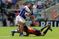 Alafoti Faosiliva of Samoa offloads in the tackle during the iRB Marriott London Sevens at Twickenham on Sunday 13th May 2012 (Photo by Rob Munro)