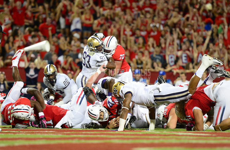 Oct. 20, 2012; Tempe, AZ, USA; Arizona Wildcats quarterback (10) Matt Scott scores a rushing touchdown in the second quarter against the Washington Huskies at Arizona Stadium. Mandatory Credit: Mark J. Rebilas-