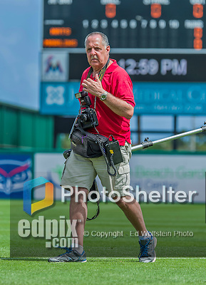 10 March 2015: Baseball photographer Steve Moore walks to his photo position during a Spring Training game between the Washington Nationals and the Miami Marlins at Roger Dean Stadium in Jupiter, Florida. The Marlins edged out the Nationals 2-1 in Grapefruit League play. Mandatory Credit: Ed Wolfstein Photo *** RAW (NEF) Image File Available ***