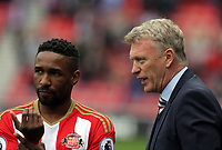 (L-R) Jermain Defoe of Sunderland is given directions by Sunderland manager David Moyes during the Premier League match between Sunderland and Swansea City at the Stadium of Light, Sunderland, England, UK. Saturday 13 May 2017