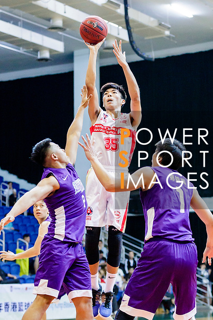 Yip Yiu Pong #35 of Nam Ching Basketball Team tries to score against the HKPA during the Hong Kong Basketball League game between Nam Ching and  HKPA at Southorn Stadium on June 12, 2018 in Hong Kong. Photo by Yu Chun Christopher Wong / Power Sport Images