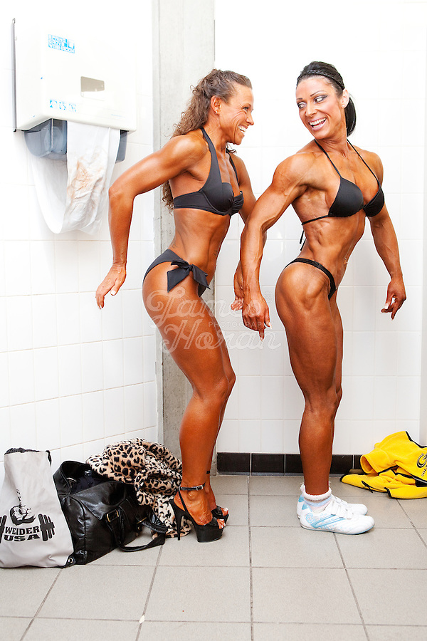 23/10/2010. Irish female physique and figure fitness national championships.  Margaret Mc Grath from Carlow and Sophia Mc Namara (1st place winner) from Limerick are pictured pumping up backstage during the female physique category as part of the 2010 RIBBF national bodybuilding championships at the University of Limerick Concert Hall, Limerick, Ireland. Picture James Horan