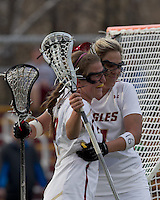 Boston College attacker Brooke Blue (4) celebrates her goal with teammates. Boston College defeated University of Vermont, 15-9, at Newton Campus Field, April 4, 2012.