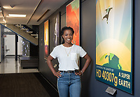 Poster for HD 40307 g, an exoplanet orbiting in the habitable zone of HD 40307. It is located 42 light-years away in the direction of the southern constellation Pictor.<br /> Occidental College student Tre'Shunda James '19 is a Jet Propulsion Laboratory Research Intern at NASA's JPL in Pasadena. Tre'Shunda is working with Dr. Renyu Hu studying oxygen in terrestrial exoplanet atmospheres and is also working on a project for the Undergraduate Research Center's Summer Research Program.<br /> Photo taken July 12, 2018.<br /> (Photo by Marc Campos, Occidental College Photographer)