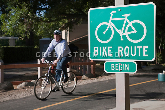 A bike route sign marks the path as a bicycle commuter exits the Stevens Creek Trail at the southern extension that just opened at Sleeper Avenue. Photo taken 5/14/09. Mountain View, California, USA