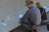 May 12, 2013  (Washington, DC) A New York State Police Trooper pays tribute to a fallen officer whose name is etched in the wall of the National Law Enforcement Officers Memorial in D.C.    (Photo by Don Baxter/Media Images International)