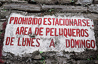 "A sign on the street says ""parking is prohibited, area reserved for barbers,  monday through sunday."" Xilitla, a small village in the Sierra Gorda of Mexico where surrealist artist and British blue blood Edward James chose to settle and construct his surrealist sculptures in its jungles."