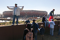 Fans have their photos taken outside Soccer City in Johannesburg, South Africa on Thursday, June 17, 2010 before Argentina's and South Korea FIFA World Cup first round match.
