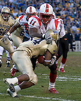 Louisville linebacker Malik Jackson (11) tackles Pitt running back LaRod Stephens-Howling.  The Louisville Cardinals defeated the Pitt Panthers 48-24 on November 25, 2006 at Heinz Field, Pittsburgh, Pennsylvania.