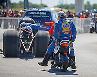 Sep 4, 2016; Clermont, IN, USA; NHRA funny car driver Ron Capps heads back to the pits after crashing during qualifying for the US Nationals at Lucas Oil Raceway. Mandatory Credit: Mark J. Rebilas-USA TODAY Sports