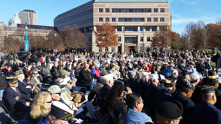 A crowd numbering more than 400 attended the dedication of the Connecticut State Veterans Memorial at Minuteman Park in front of the William A. O'Neill Armory and the Legislative Office Building in Hartford. Dozens of veterans were in attendance. Paul Hughes/ Republican-American
