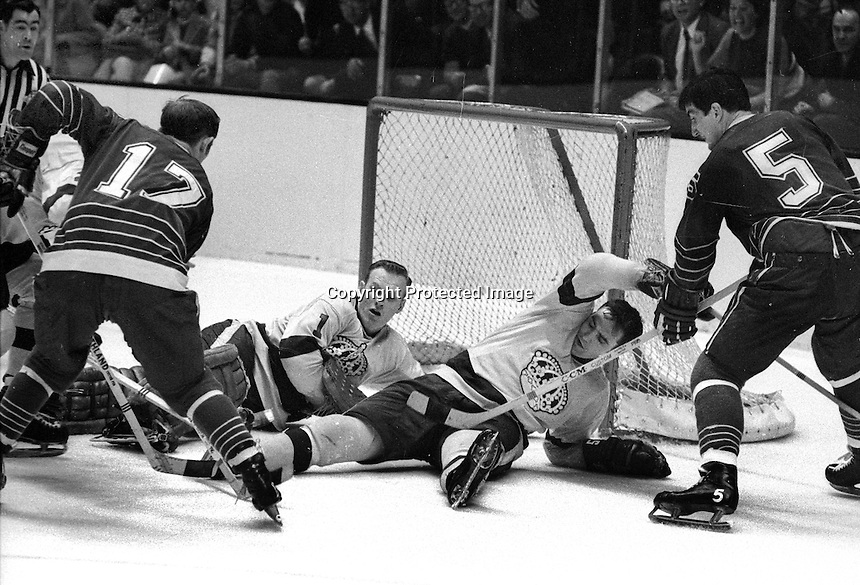 Seals Norm Ferguson and Carol Vadnais ready to pounce on prone LA Kings Golie Gary Desjardins, and Ross Lonsberry...(1970 photo/Ron Riesterer)