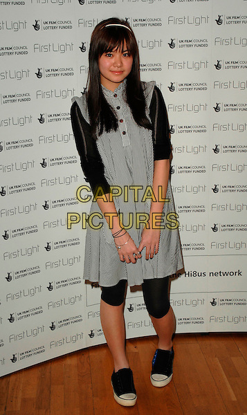 KATIE LEUNG.The First Light Film Awards, Odeaon West End, London, UK..February 27th, 2007.full length black white leggings dress converse trainers sleeveless striped stripes .CAP/CAN.©Can Nguyen/Capital Pictures