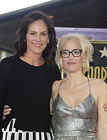 HOLLYWOOD, CA - JANUARY 8: Annabeth Gish, Gillian Anderson, at Gillian Anderson Honored With Star On The Hollywood Walk Of Fame at On The Hollywood Walk Of Fame in Hollywood, California on January 8, 2018. <br /> CAP/MPI/FS<br /> &copy;FS/MPI/Capital Pictures