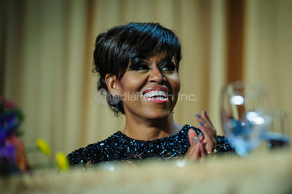 First Lady Michelle Obama reacts to a joke told by her husband United States President Barack Obama during the White House Correspondents' Association (WHCA) annual dinner in Washington, District of Columbia, U.S., on Saturday, April 27, 2013.<br /> Credit: Pete Marovich / Pool via CNP /MediaPunch