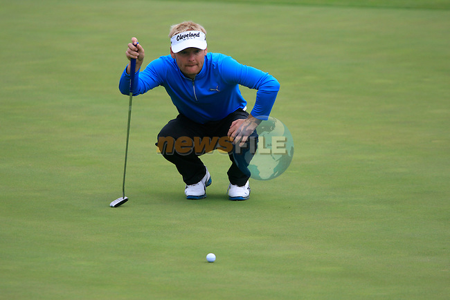 Soren Kjeldsen (DEN) lines up his putt  on the 8th green during Day 2 of the Volvo World Match Play Championship in Finca Cortesin, Casares, Spain, 20th May 2011. (Photo Eoin Clarke/Golffile 2011)