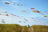USA, Washington State, Long Beach Peninsula, boy runs with his kite at the International Kite Festival