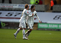 Pictured: Jordi Gomez of Swansea (R) celebrating the goal he scored from a free kick with team mate Thomas Butler (L)<br />