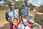 Farmers display their favorite foods and recipes in an educational event in Edundu, Malawi. They and others in the village have benefited from intercropping and crop rotation practices they learned from the Malawi Farmer-to-Farmer Agro-Ecology project of the Ekwendeni Mission Hospital AIDS Program, a program of the Livingstonia Synod of the Church of Central Africa Presbyterian.