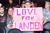 "Joseph Hajec, 10, of Springfield, Mass., holds a sign reading ""Love for Landen"" at a WWE Live Summerslam Heatwave Tour event at the MassMutual Center in Springfield, Massachusetts, USA, on Mon., Aug. 14, 2017. Hajec said the sign was made to show support for a friend diagnosed with brain cancer."
