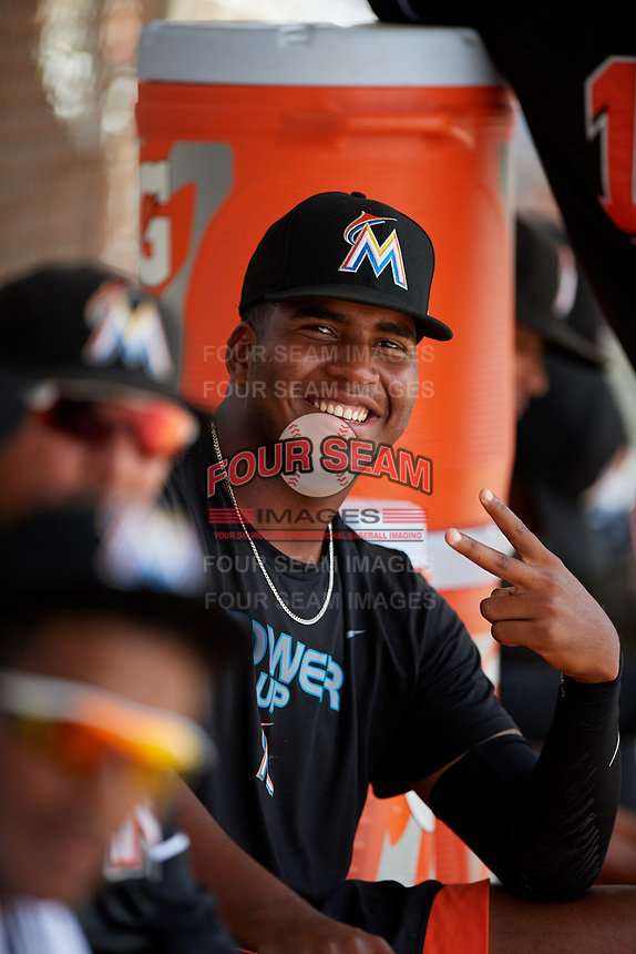 GCL Marlins pitcher Alberto Guerrero (43) poses for a photo in the dugout during the second game of a doubleheader against the GCL Nationals on July 23, 2017 at Roger Dean Stadium Complex in Jupiter, Florida.  GCL Nationals defeated the GCL Marlins 1-0.  (Mike Janes/Four Seam Images)