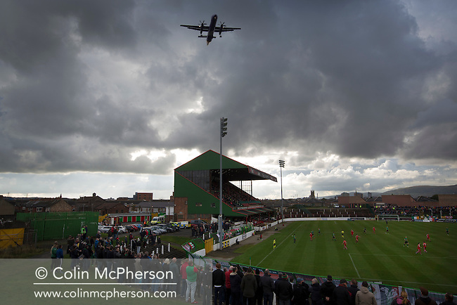 An aircraft flies over The Oval, Belfast as Glentoran host city-rivals Cliftonville in an NIFL Premiership match. Glentoran, formed in 1892, have been based at The Oval since their formation and are historically one of Northern Ireland's 'big two' football clubs. They had an unprecendentally bad start to the 2016-17 league campaign, but came from behind to win this fixture 2-1, watched by a crowd of 1872.