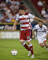 FC Dallas forward Kenny Cooper (33) advances the ball.  New England Revolution defeated FC Dallas 3-2 to capture the 2007 Lamar Hunt U.S. Open Cup at Pizza Hut Park in Frisco, TX on October 3, 2007.
