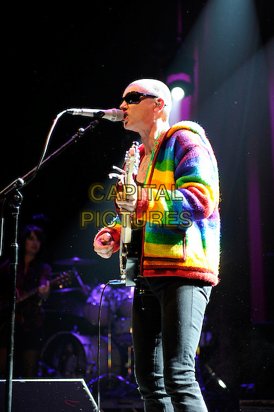 Sinead O'Connor<br /> Performing at Glastonbury Festival, Worthy Farm, Pilton, Somerset, <br /> England, UK, 28th June 2013.<br /> half length live on stage concert gig microphone sunglasses singing  red multi-coloured rainbow  cardigan guitar <br /> CAP/MAR<br /> &copy; Martin Harris/Capital Pictures