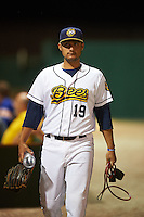 Burlington Bees pitcher Zach Varela (19) walks to the dugout after a game against the Clinton LumberKings on August 20, 2015 at Community Field in Burlington, Iowa.  Burlington defeated Clinton 3-2.  (Mike Janes/Four Seam Images)