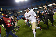 December 7, 2013  (Charlotte, North Carolina)  Florida State Seminoles quarterback Jameis Winston #5 runs to the locker room following a media availability after his team won the ACC Championship December 7, 2013. Winston was named game MVP. (Photo by Don Baxter/Media Images International)
