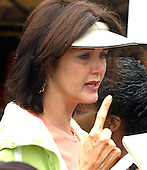 """Actress Lynda Carter has a conversation with an unidentified person at the """"March for Women's Lives"""" in Washington, DC on April 25, 2004..Credit: Ron Sachs / CNP"""