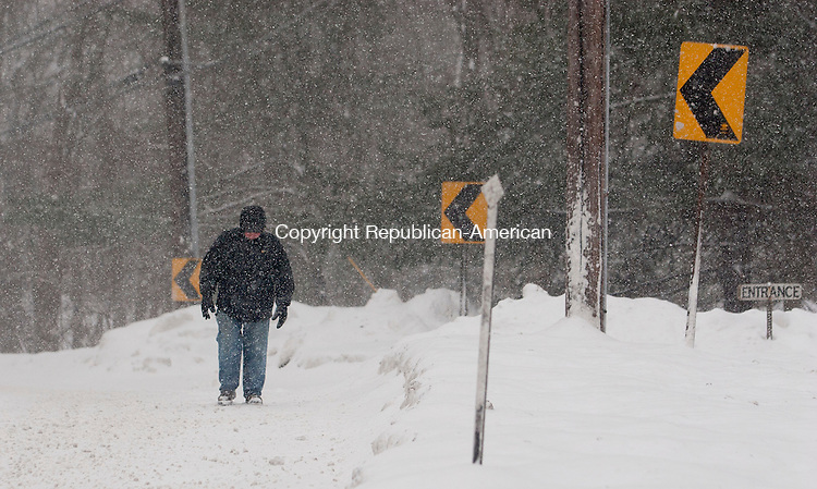 CHESHIRE, CT-13 February 2014-0201314BF01- John Ferrara from Prospect makes his way along Rt. 70/Waterbury Road in Cheshire Thursday morning during the storm. Ferrara said he was just out for a walk.   Bob Falcetti Republican-American
