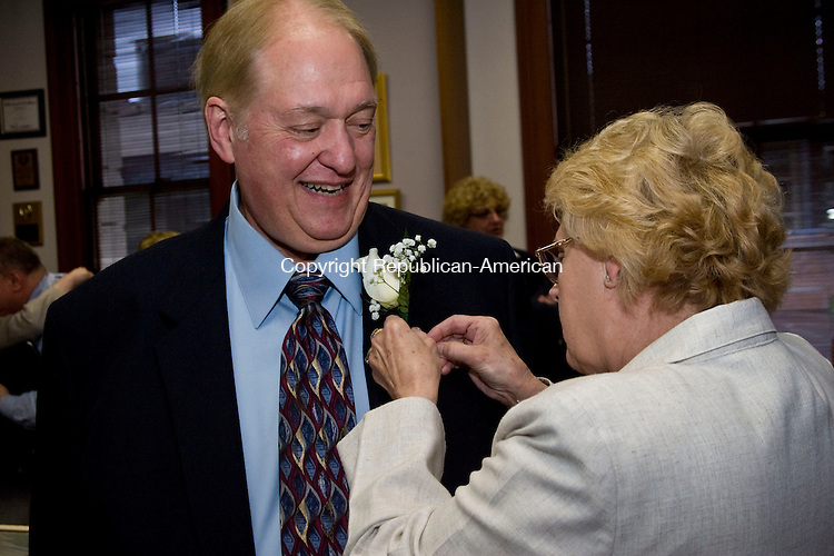 WATERBURY, CT - 09 JUNE 2010 -060910JT03-<br /> Waterbury Arts and Tourism Commissioner Victoria DiChiara pins a boutonniere on Philip Benevento just before he receives the Arts and Tourism Commission 2010 Cultural Award at the Mayor's Conference Room on Wednesday. Benevento was an English teacher at Crosby High School, where he fostered enrichment courses in creative writing, African-American literature, minority voices and drama, for 34 years before becoming the city historian.<br /> Josalee Thrift Republican-American