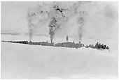 Three New Mexico Lumber Co. locomotives (l-r #3, #5, #1) pushing a wedge plow through deep snow.  A large group of snow shovelers is riding on the plow.<br /> New Mexico Lumber Co.  Morrison Ranch (near), CO  Taken by Long, Morris - ca. 1926-1929