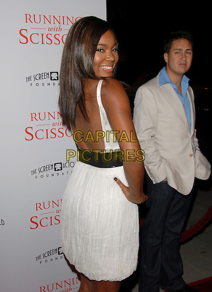"GABRIELLE UNION.attends The TrisStar Pictures' World Premiere of ""Running with Scissors"" held at The Academy of Motion Pictures Arts & Sciences in Beverly Hills, California, USA, October 10th 2006..half length white dress low back behind hand on hip.Ref: DVS.www.capitalpictures.com.sales@capitalpictures.com.©Debbie VanStory/Capital Pictures"
