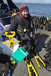 A survey diver with offset distance reel and improvised writing slate (chopping board). (Photo Shane Wasik Photography)